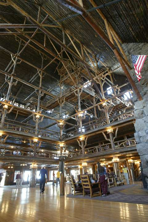 Daylight filtering down through the seven-story interior of the Old Faithful Inn recalls the light in a leafy forest. NPS photo, via Wikipedia.