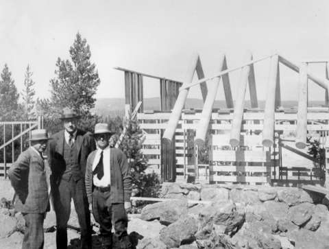 Scientist and educator Hermon Bumpus, left, Rockefeller representative Kenneth Chorley, center, and architect Herbert Maier. Bumpus had recommended series of rustic roadside museums for Yellowstone's automobile tourists. The men stand in front of one under construction at Madison Junction, 1930. NPS photo.