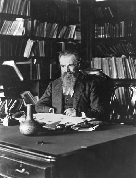 John Wesley Powell at his desk in Washington, D.C., in 1896. Under intense pressure from his political enemies, he had resigned his directorship of the U.S. Geological Survey two years earlier, but stayed on as head of the U.S. Bureau of Ethnology. Wikipedia.
