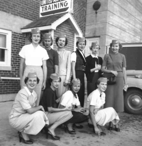 This July 1951 class of stewardesses posed in their new caps in front of the United Air Lines Cheyenne Training Facility. Front row, left to right, Patricia Seibel, unidentified, Mary Morris, Susie Huggins. Back row, fourth from left is Norma Hale, others unidentified. Courtesy Patricia Seibel Romeo.