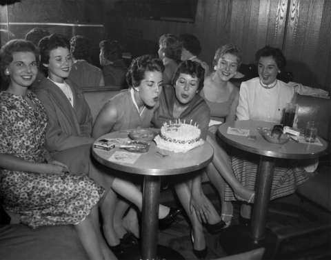 Pat Sloan of Louisville, Ky., center left, and Ann Dempsey of Seattle, center right, celebrate their birthdays in June 1958 with other trainee friends at the Wigwam Lounge in the Plains Hotel, Cheyenne, a favorite trainee meeting place at the time. Wyoming State Archives.