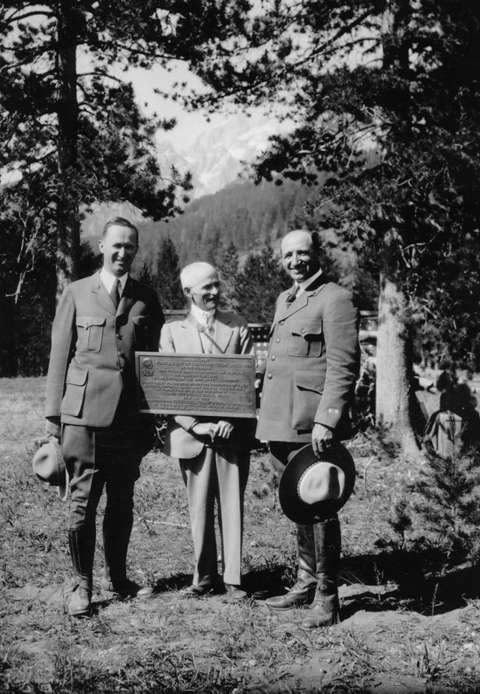 Billy Owen, center, with his first-ascent plaque when the new Grand Teton National Park was dedicated, 1929. At left is National Park Service Supt. Horace Albright; Teton Park Supt. Sam Woodring stands at right. Wyoming State Archives.