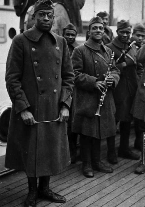 Lt. James Reese Europe, with baton, and musicians of his 369th Infantry Hellfighters Band, ca. 1918. Wyoming Veterans Memorial Museum.