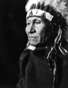 Northern Arapaho Council Chief Lone Bear, shown here in traditional dress, objected in 1904 that the 1.5 million acres north of the Big Wind River were worth twice what the government was offering. Joseph Dixon photo, Wyoming Veterans Memorial Museum.