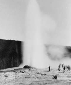 Even in 1883, Old Faithful drew crowds of tourists—and an artist at his easel—as well as the members of the president's expedition. F. Jay Haynes photo, Library of Congress.