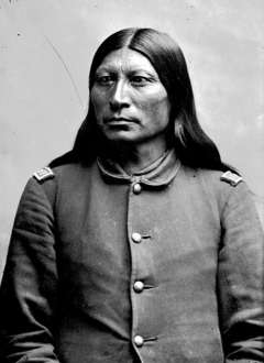 The Arapaho and their chief, Sharp Nose, shown here around 1880 in the uniform of an army scout, preferred cattle and rations in exchange for the land around the hot springs. American Heritage Center.